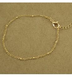 Minimalistisk guldfarvet armbånd