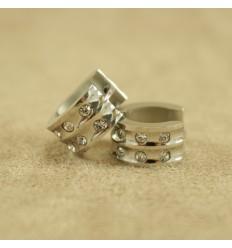 Sølvfarvet creol med to rækker klare krystaller, bred