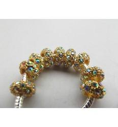 Guldfarvet med multifarvede krystaller