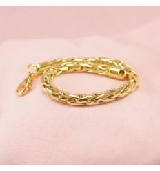 Kraftigt guldfarvet armbånd