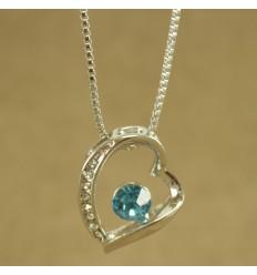 Halskæde med skævt hjerte og lys blå krystal