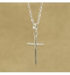 Minimalistisk sølvfarvet kors
